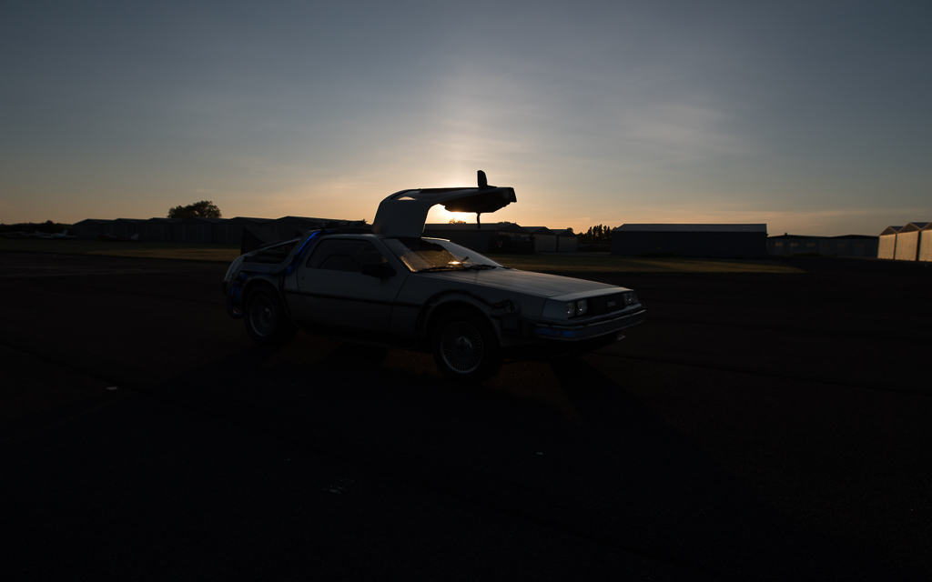 Back to the Future styled DMC DeLorean at sunset on a runway (unedited)
