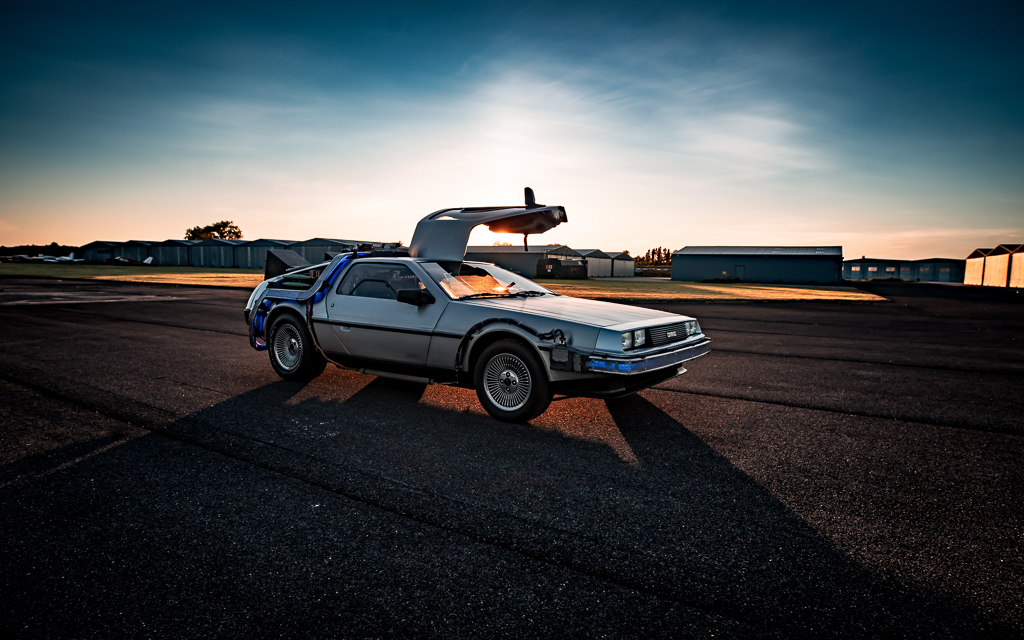 Back to the Future styled DMC DeLorean at sunset on a runway