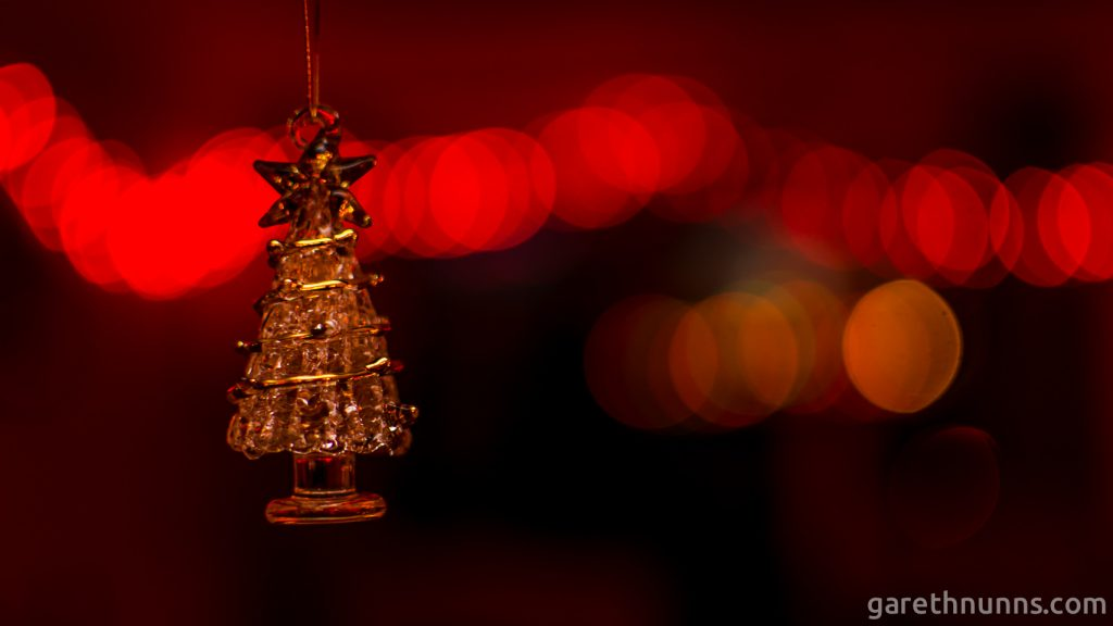 Christmas tree decoration with blurred Christmas lights behind