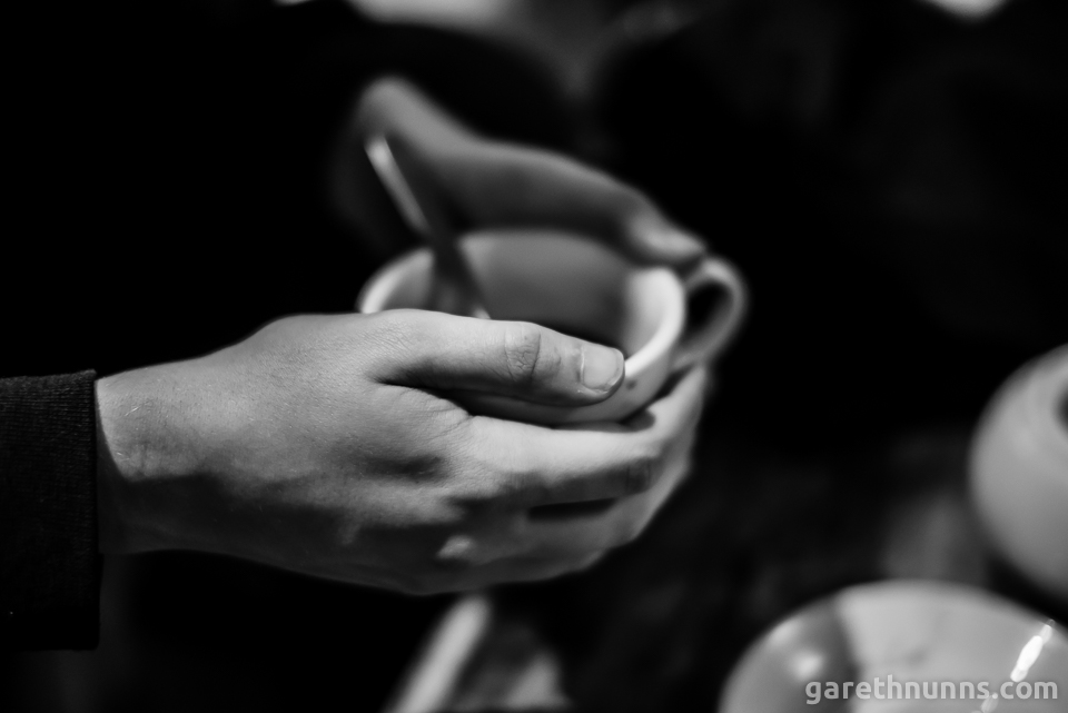 Holding coffee cup in hands in black and white