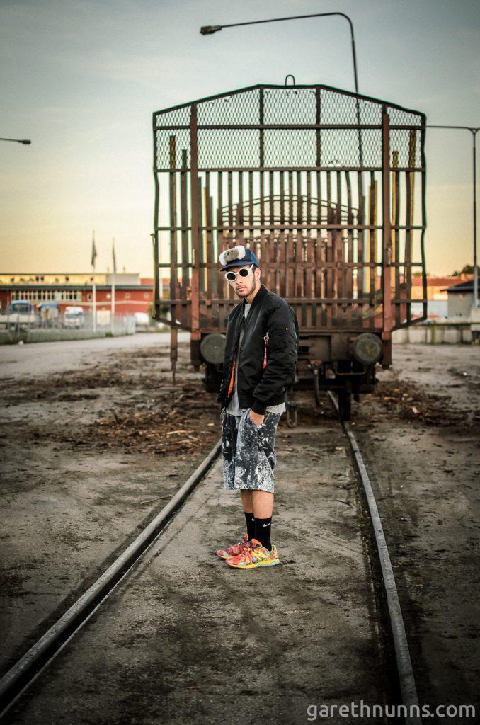 Kristian David model photoshoot on train tracks