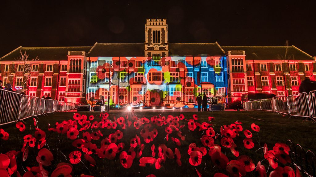 Rememberance Sunday Poppies projection mapped onto the Hazlerigg Building at Loughborough University