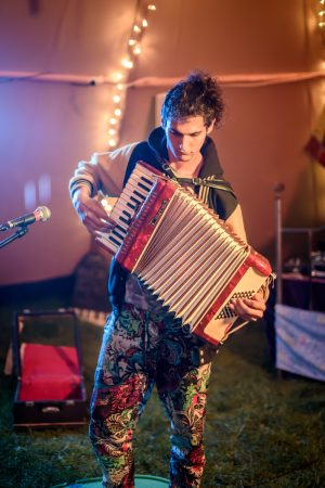 Ru Kogo playing accordion