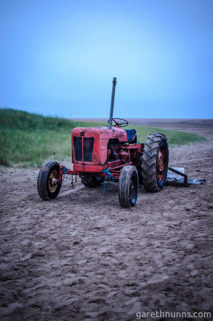 Tractor on the beach in Northumberland